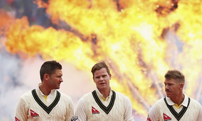 Michael Clarke, Steve Smith and David Warner of Australia look on during the opening ceremony of the First Test.