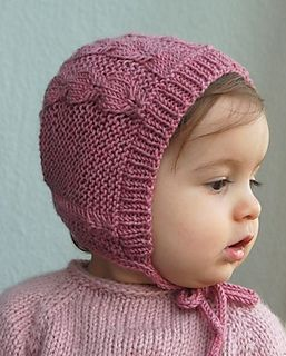This adorable, easy and seamless bonnet for your little ones features a lovely cable pattern that is designed to match the Silverfox cardigan.