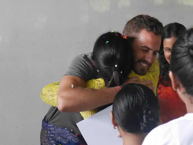 Marcel getting goodbye hugs from his students :)