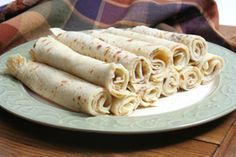 Norwegian Lefse. Huge Christmas tradition at our house. Had to have the lefsa, spread with a think layer of butter and sprinkled with sugar. Roll it together and yum, yum!