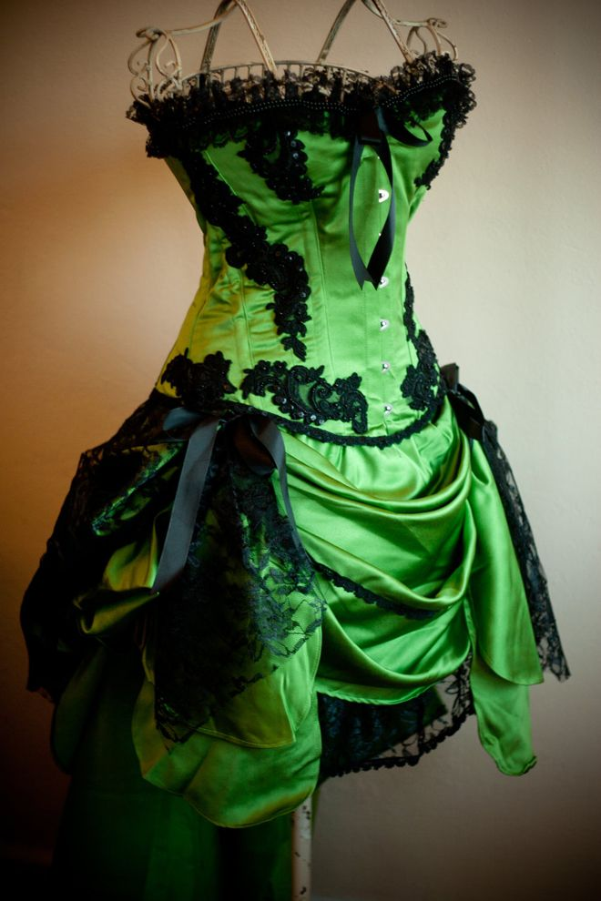 Etsy's Olga Italy specializes in burlesque corset costumes, and we find this green gypsy corset to be truly exquisite. Verdant green satin and flowing black lace implies gossamer wings.