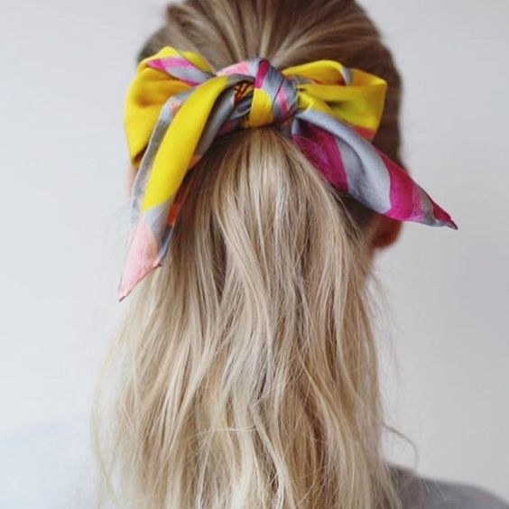 We love how this scarf is worn tied around a pony tail.