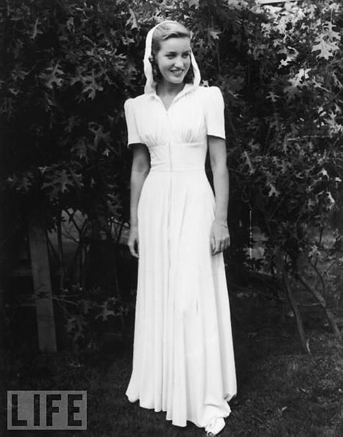 U.S. American socialite Edith Beale (1917 - 2002) models a dress outdoors during a fashion show at the East Hampton Fair, East Hampton, Long Island, New York, c. 1938. // Photo by Morgan Collection/Getty Images