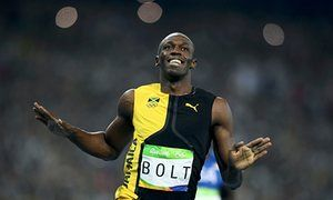 Usain Bolt celebrates as he crosses the line to win the 100m final.