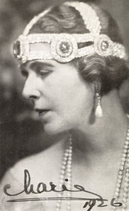Queen Marie of Roumania 1926 in a bandeau with the sapphire elements from the Grand Duchess Vladimir sapphire tiara (these were removable and could be used as brooches, or as here, attached to another head ornament).