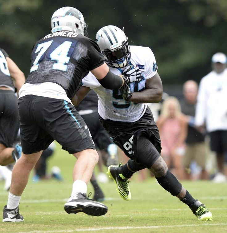 Carolina Panthers' Mike Remmers (74) works to fend off teammate Charles Johnson (95) during Carolina Panthers Training Camp at Wofford College in Spartanburg, SC on Sunday, August 9, 2015.