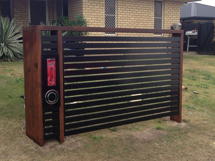 Letterbox feature. Made with leftover slats from carport and a couple of sleepers. Great result. !