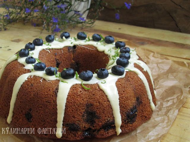 Cake with blueberries, coconuts and white chocolate glaze