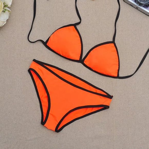 Woman's New Orange Bikini Set (M) Woman's new sexy orange swimsuit bikini set. Great for summer. Size Medium. Fast shipping. Bundle and save. Thank you. Bikini Nation Swim Bikinis