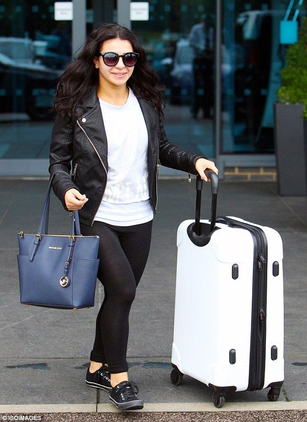 On the move: Gymnast Claudia Fragapane wheeled her white suitcase to her car...