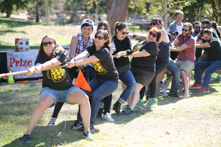 Employees Play Tug-of-War at Bookside Park