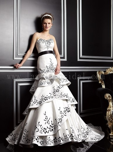 #4 This Jasmine Bridal wedding gown has a detachable skirt. The ivory and black color detail really makes this a unique wedding dress