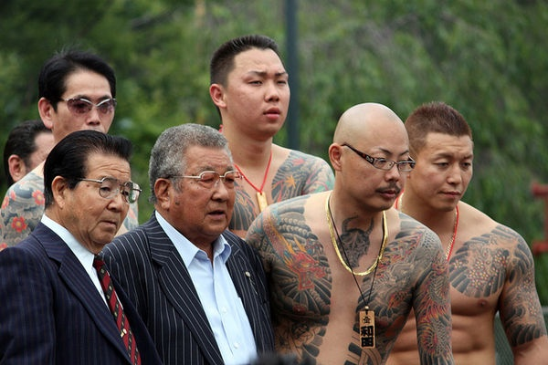 """""""Yakuza (ヤクザ or やくざ), also known as gokudō (極道), are members of traditional organized crime syndicates in Japan. The Japanese police, and media by request of the police, call them bōryokudan (暴力団), literally """"violence group"""", while the yakuza call themselves """"ninkyō dantai"""" (任侠団体 or 仁侠団体), """"chivalrous organizations"""". ... """" http://en.wikipedia.org/wiki/Yakuza"""