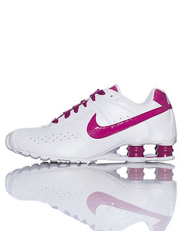 NIKE Low top womens sneaker Lace up front closure Padded leather tongue  with Shox logo Open heel with shock support NIKE signature swoosh on both  sides