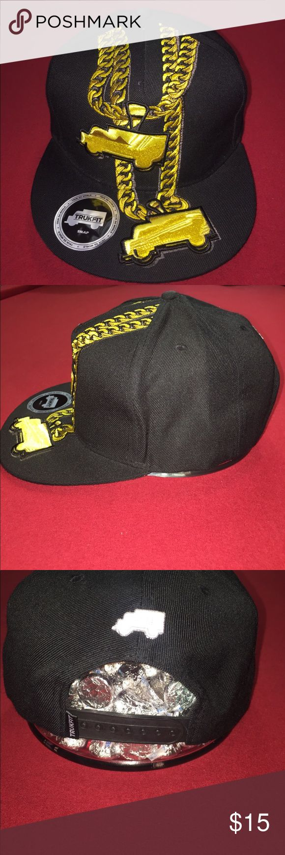 Original Trukfit SnapBack hat Brand new, black with yellow chain detail Trukfit hat. SnapBack Trukfit by Lil Wayne Accessories Hats