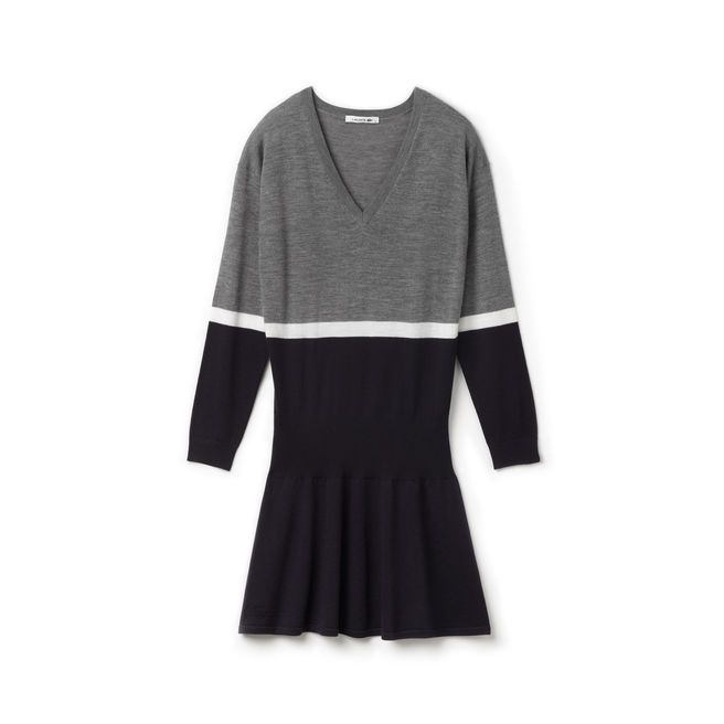 Colorblock Sweater Dress. With books and a backpack and ankle boots.