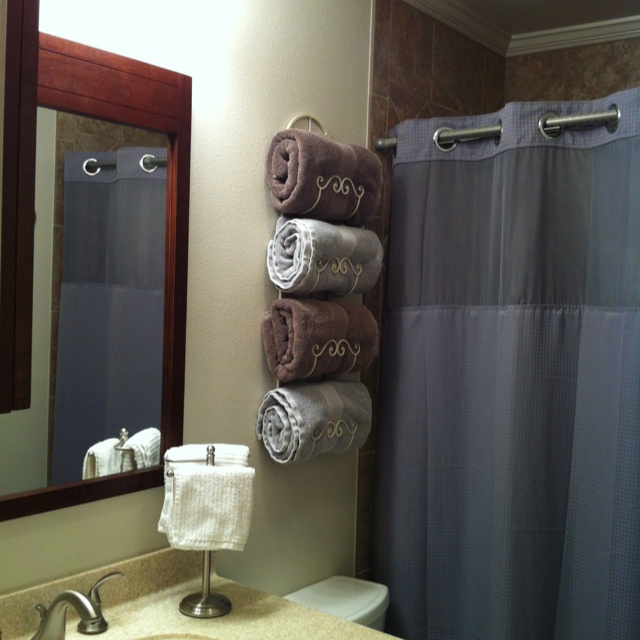 wine rack used to hold towels in small bathroom stuff to try pinterest wine bathroom and. Black Bedroom Furniture Sets. Home Design Ideas