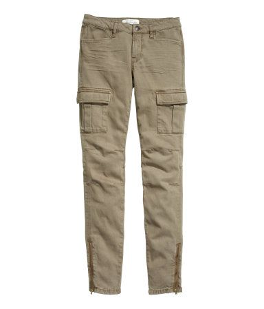 CONSCIOUS. Cargo pants in washed stretch twill with slim legs. Back and leg pockets with flap and concealed fastener. Side pockets, seams at knees, and zip at hems. Made partly of Tencel® lyocell.