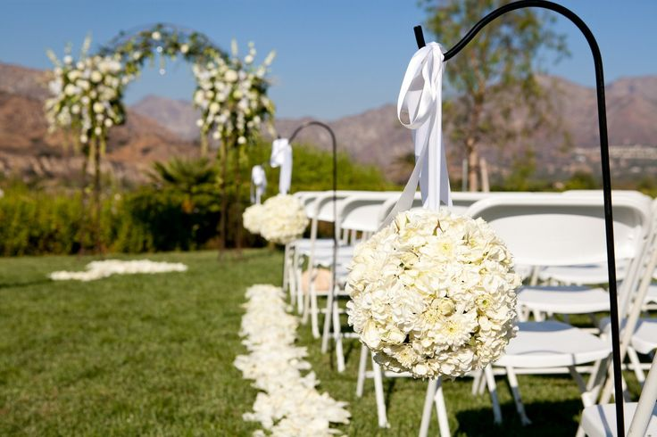 Arch for outdoor wedding...this is simple, tried, and true way to add elegance to your outdoor ceremony