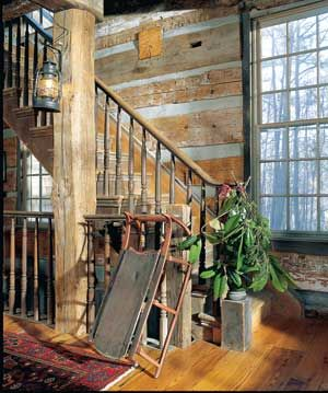 Old sled & pine on the bannister, love the walls and stair's wood work