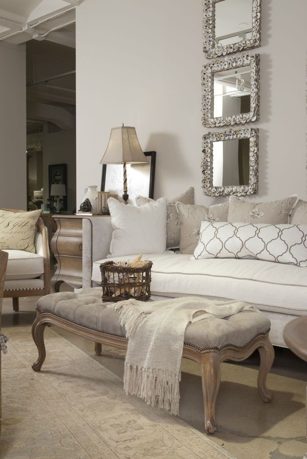 neutral palette adds richness through texture. love the placement of the 3 mirrors which are unexpected and take advantage of the high ceiling