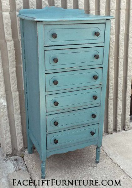 Narrow Chest of Drawers in distressed Sea Blue with Black Glaze. New knobs. From Facelift Furniture's Chests of Drawers collection.