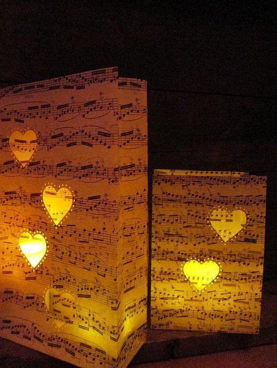 Heart sheet music luminaries - http://themerrybride.org/2015/05/09/table-setting-ideas/
