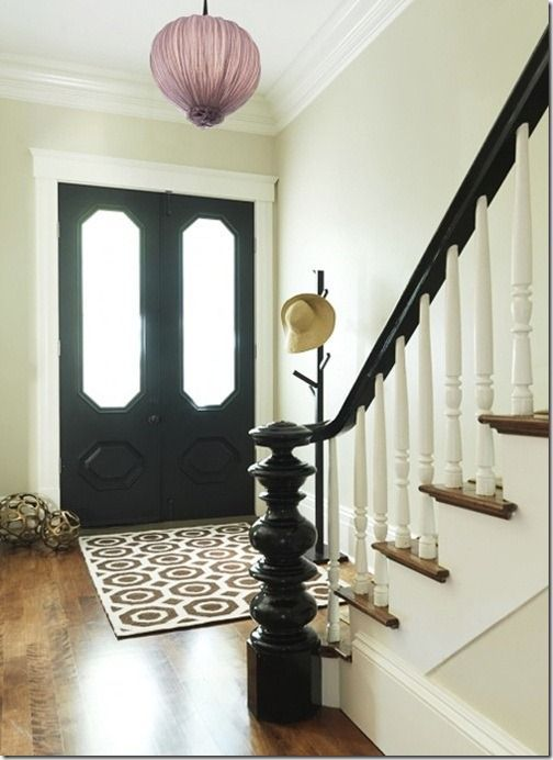 Black painted stair handrails and black front door