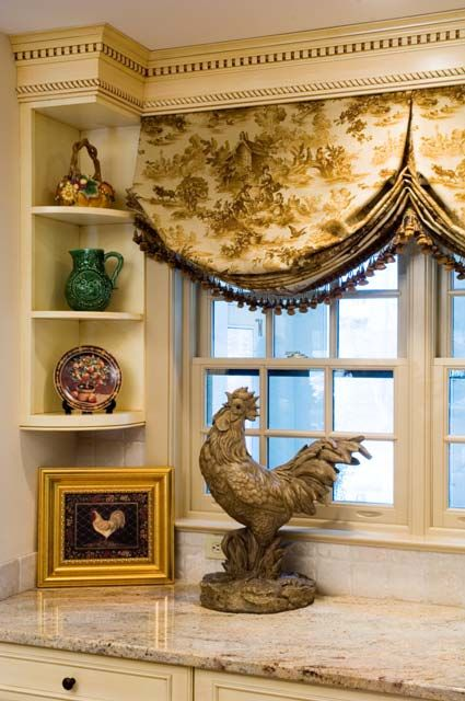 Add a toile valance with fringe and a rooster to your kitchen for an instant Country French splash to an otherwise ordinary looking kitchen. - lil' designer