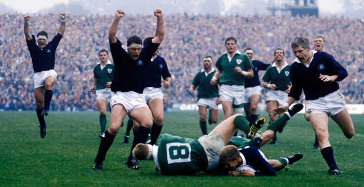 + / Graham Shiel is the only back in sight as he crashes through Irish No.8 Paddy Johns to score at Murrayfield during the 1991 World Cup. David Sole, John Allan, Paul Burnell, Chris Gray, Finlay Calder and Doddie Weir celebrate the score!
