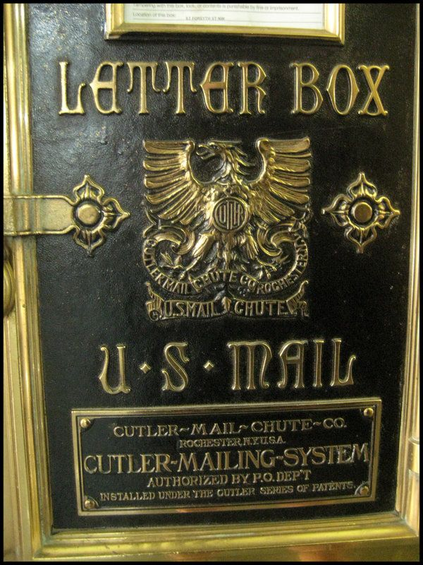 Detail of one of two letter boxes -- attached to mail shutes -- in the Healey Building