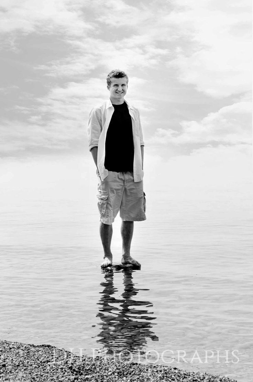 Port Huron Senior Portraits, senior picture ideas, senior inspiration, senior photos by DH Photographs   www.dhphotographs.com Keywords: water, beach, guy, standing, rock, 2015, class of