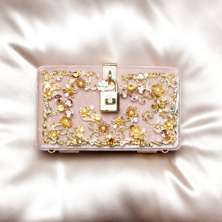 Dolce & Gabbana's elegant and ornate clutch is perfect for wedding guest attire.