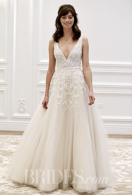 An A-line @annebargebride wedding dress with a deep V-neck | Brides.com