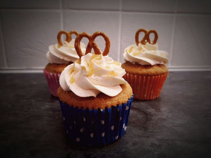 Caramel filled vanilla cupcakes with caramel buttercream, caramel drizzle and topped with a mini pretzel