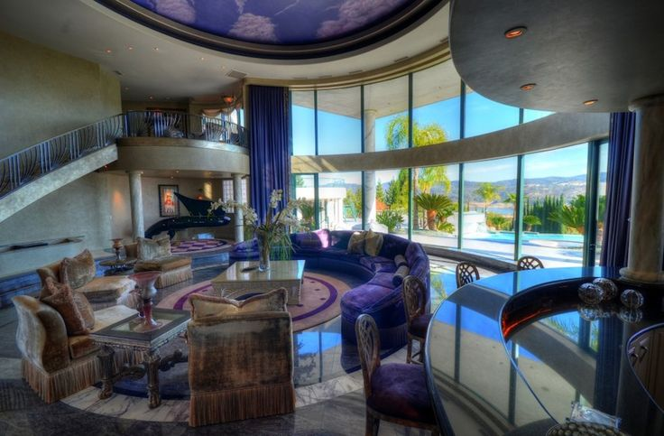 The 38 foot diameter rotunda is flanked by two massive curved staircases. It boasts 20 foot high curved glass windows, the rare Schimmel Pegasus piano, wet bar, fibre optic starlit mural on the ceiling, and views of Folsom Lake and pristine landscaping. Granite Bay Mountaintop Estate – $12,000,000 Previously Owned By Eddie Murphy, 12,600 Sq. Ft. and 5,200 sq. ft. guest house.