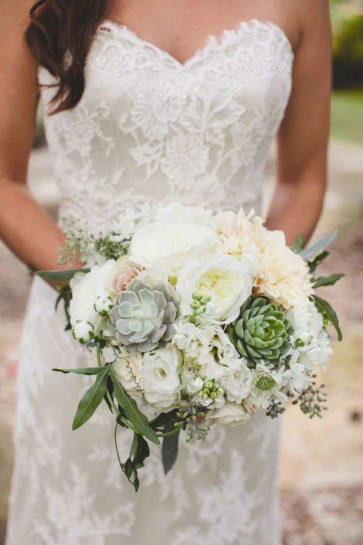 celeste carried a textured bunch of white garden roses peonies hydrangeas succulents