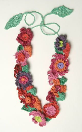 Wow this is made from recycled plastic bags! People make cute bags and other stuff too...sweet
