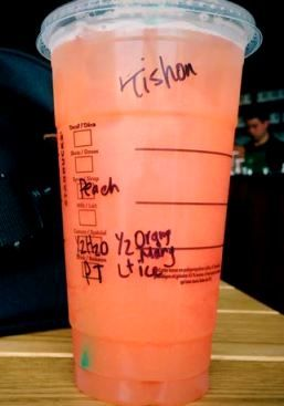 Fuzzy Peach! Passion Iced Tea made with half water and half orange mango purée w/light ice, Peach syrup instead of the classic syrup.