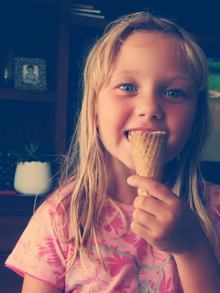 cute little girl, my cousin eating an icecream and smiling