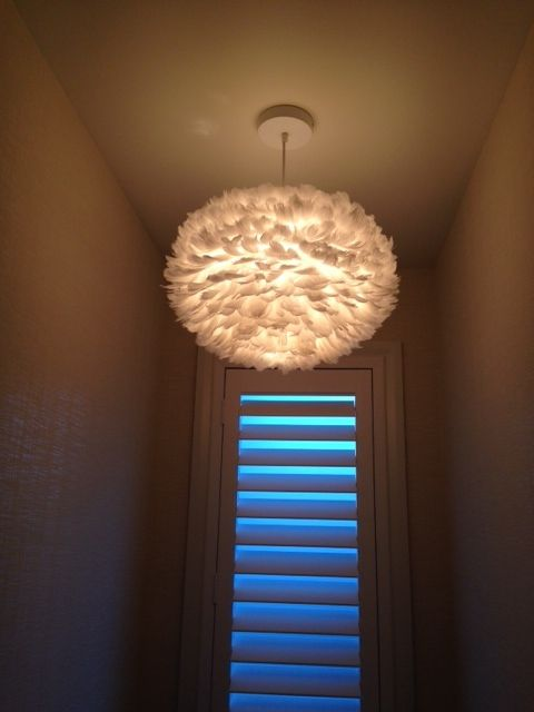 And here it is all lit up ........stunning :) New Home Takapuna #lighting #feathers #interiordesign #powderroom #bathroom #designer #design #shutters