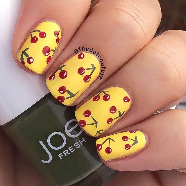 Hand-painted cherry nail art.  Base is @sally_hansen Xtreme Wear Mellow Yellow, and the cherries are hand-painted with @zoyanailpolish Rekha, #JoeFresh Khaki, and @chinaglazeofficial White on White. ❤️