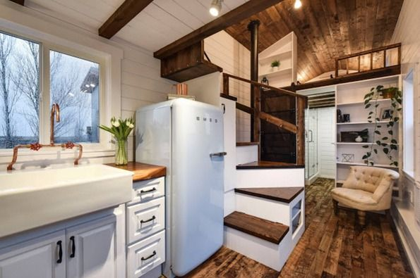 This is a Rustic Glamour tiny home on wheels built by Mint Tiny House Company. It was a custom build designed to the new owner's personal taste.The home features the very popular and stylish…