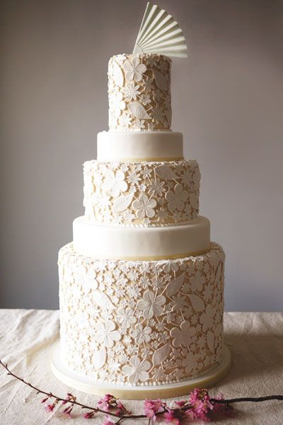 This beautiful cake is a masterpiece - and very easy to personalise! The lace effect can be matched to your veil or bodice embroidery, to create a cake truly unique to you.