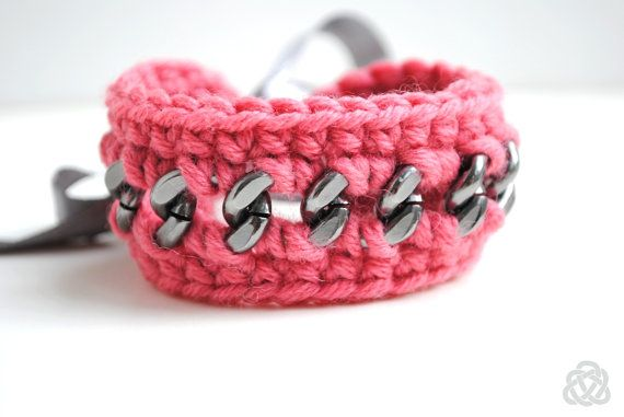 Crocheted coral eco-wool bracelet on chunky grey by elfinadesign