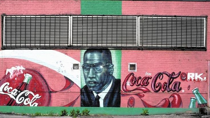"""In the pantheon of heroes painted on the walls of South Los Angeles, Detroit, Chicago and New York, Malcolm X is a stern, somewhat ghostly presence. He's there, but not as frequently as the sunnier examples of civil rights leadership: Martin Luther King Jr., Nelson Mandela and Barack Obama. He points a finger, frowns over his serious glasses and seems to repeat his famous line: """"By any means necessary."""" Malcom X assassinated before he was 40, was born 90 years ago today."""