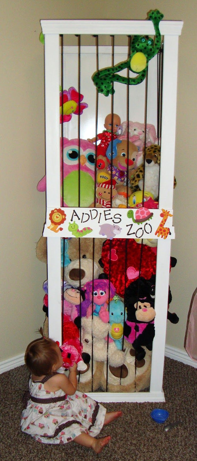 """Stuffed animal case with """"bungee"""" bars....great way to keep all those stuffed animals in the some sort of order!"""