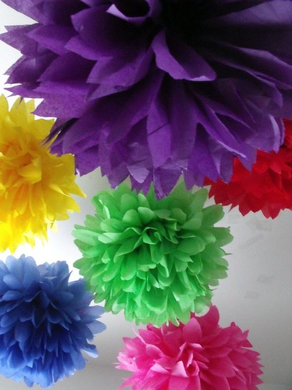 """Rainbow poms! I made these for my classroom this year, but they are supposed to be """"gumballs"""" to go with our theme. I also made some for brother and SIL's wedding a few years back, and they looked great hanging above the dance floor. They're so easy, cheap, and fast!"""