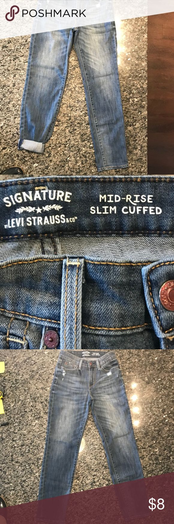 "Levi Strauss & Co Signature Mid-rise Jeans NWOT Levi Strauss & Co Signature Mid-rise Cuffed Jeans Super soft, super stretchy fabric keeps its shape all day Authentic vintage finishing and fabric character Mid-Rise 5 pocket styling Slim through hip and thigh Adjustable double cuff Size: 26 Measurements: 13"" Waist flat across, 27"" Inseam as not cuffed Signature by Levi Strauss Jeans"