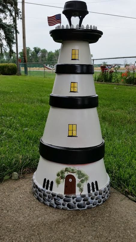 The lighthouse I made from terra cotta pots and saucer with a solar light in the top.